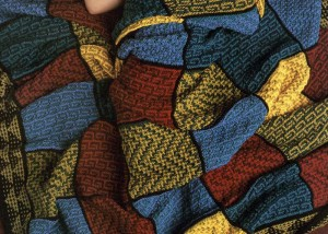 Learn how to knit this mosaic blanket knitting pattern in our FREE eBook on knitting blankets and afghans.