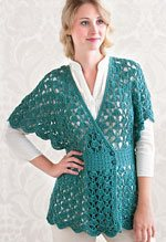 Save yarn with different crochet stitches, such as with the Spa Shawl Top by Doris Chan.