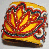 This is a great beaded jewelry example of bead embroidery, a yellow bead embroidery cuff.