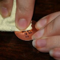 Make the stamped images pop with only a black Sharpie marker and polishing cloth.