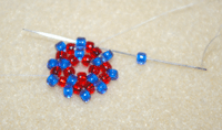 Learn how to do a circular flat peyote stitch in this expert beading blog, step 8 includes adding one last bead between a pair of beads from the previous round.