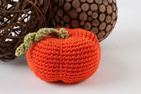 Free holiday crochet patterns including this crocheted pumpkin.