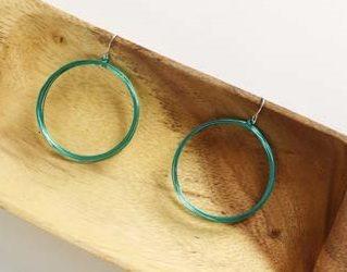 Lindsay Jarvis's green wire hoop earrings