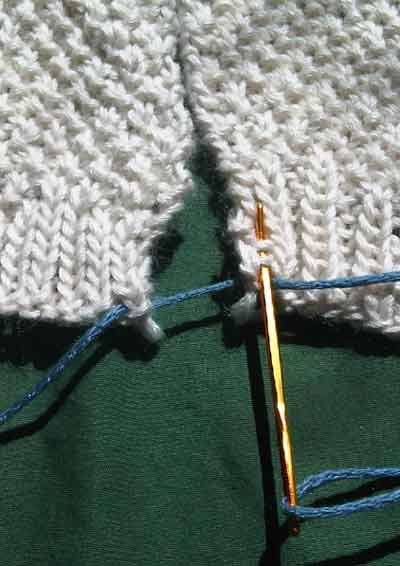 Step 1 of knitting seams together with the mattress stitch.