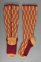 The Red Twig Knee Socks crochet pattern is found in the Free Crochet Slippers and Socks eBook and is a must have pattern for women looking to wear long socks with a skirt.