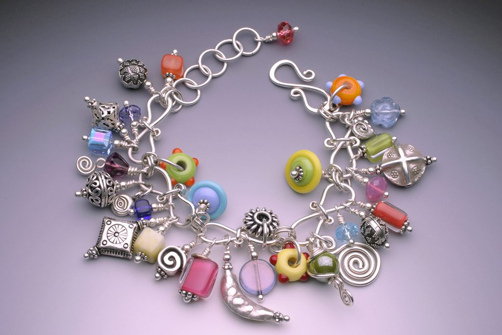 Beaded charm bracelet by Tammy Honaman. Glass beads by Worn Beadies, Hill Tribes and Bali silver beads and charms; sterling silver wire; fine silver headpins