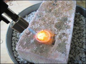 Torch in action, firing metal ring