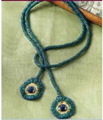 Learn to make a colorful lariat in the free Beading Patterns for Beaded Ropes eBook. The Eye of the Peacock fun necklace project can be found there.