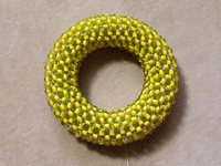 Covering Ring with Right-angle Weave Finished