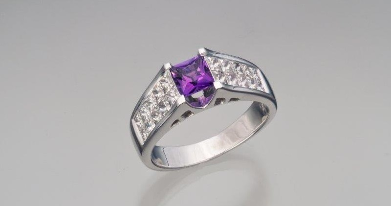 amethyst gemstones: This natural square-cut amethyst is set off dramatically by the 18k white gold and diamond surrounding it. Photo Mia Dixon. Courtesy The Collector Fine Jewelry.