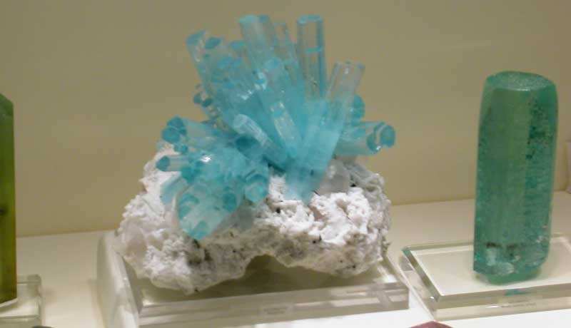 Aquamarine crystal cluster from Pakistan in a case of beryl specimens on display at the 2007 Tucson show; photo: JS White
