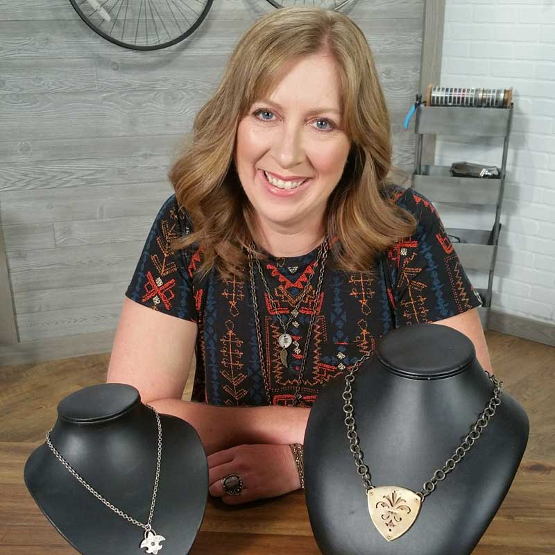 Katie Hacker on set of Beads, Baubles & Jewels, showing off pierced metal designs.