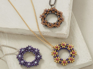 Petite Couronne Pendant by Alice Coelho This vibrant pendant uses a variation of right-angle weave, circular peyote stitch, SuperDuos, and O beads to create what looks like a little wreath.