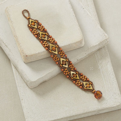 Lost in the Sahara by Hortense E. Thompson Use two-needle right-angle weave, a variation of peyote stitch, and shaped beads in a golden palette to create a bracelet of repeating arrow motifs.