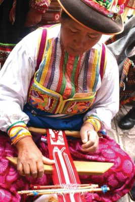 Tinkuy 2017: A backstrap weaver demonstrates her craft at the last Tinkuy. PHOTO BY ELIZABETH DOERR.