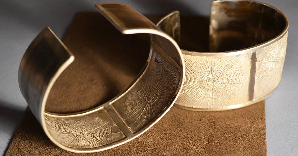 photo jewelry: etched spiderweb cuffs by Betsy Lehndorff