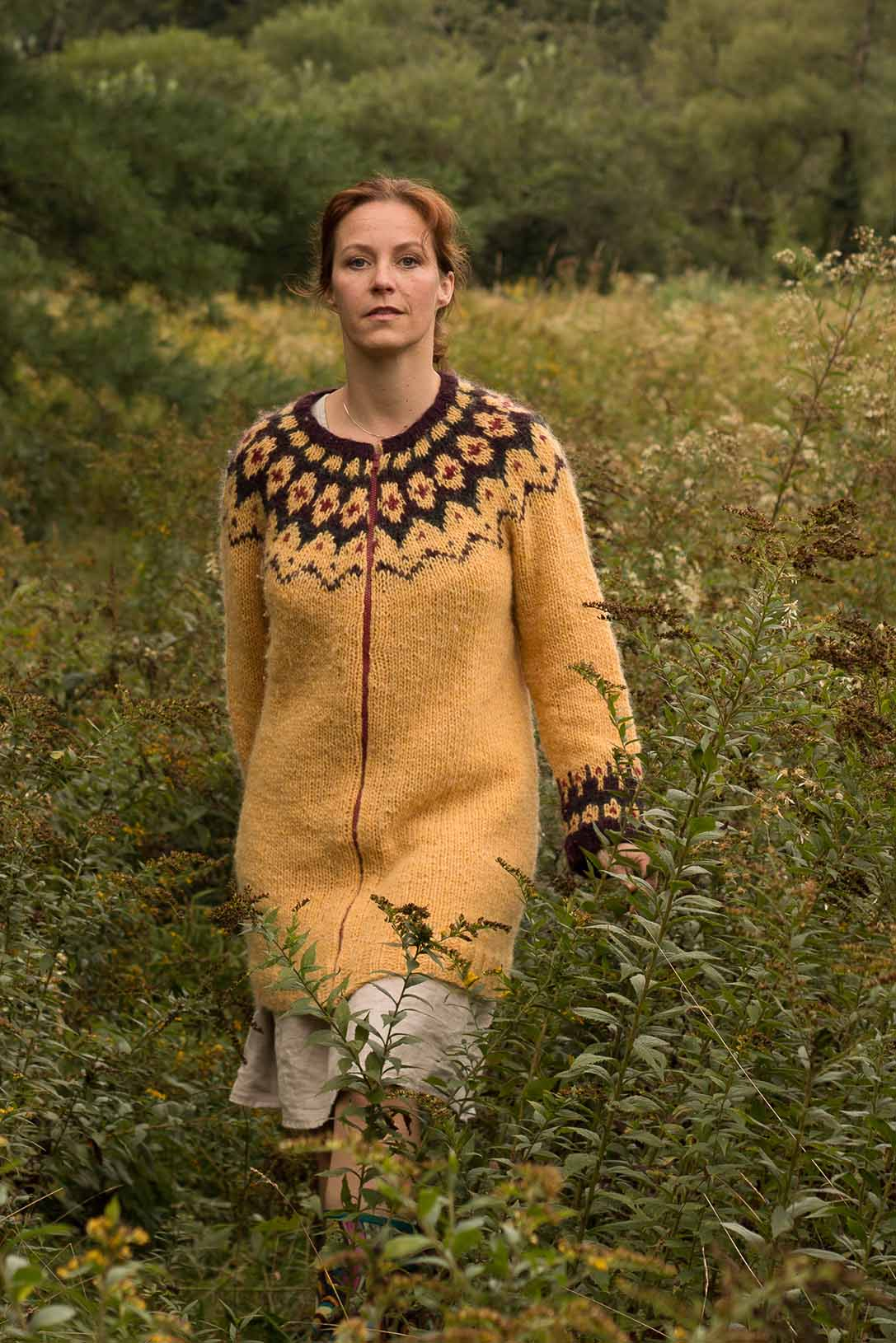 """The top-down worked round yoke sweater/-coat, Björt (which means """"bright"""" in Icelandic), is a versatile design that can be knit in either an aran- or bulky-weight yarn, resulting in two very different garments."""