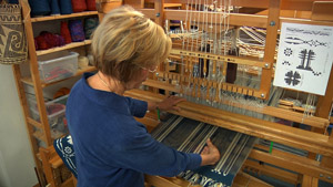 Madelyn at her loom