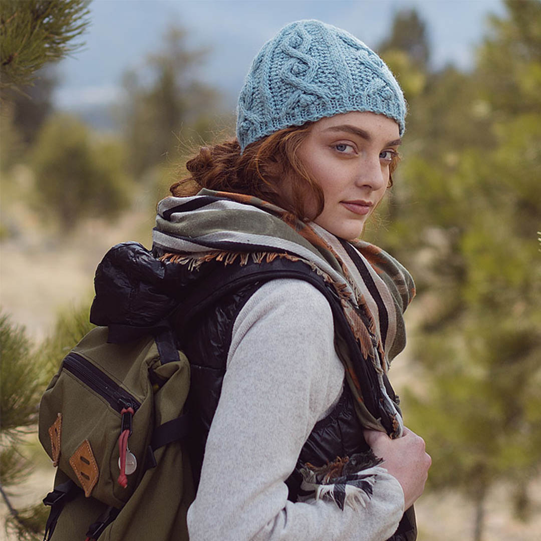 The Blue Spruce Hat uses live-loop stitches to create its cable pattern. | Photo Credit: Harper Point Photography
