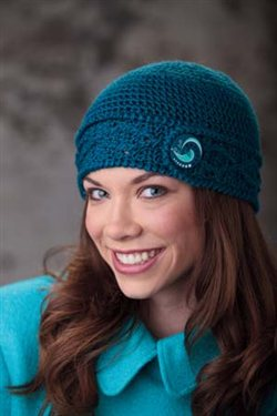 This easy cabled crochet hat is perfect with an exciting button.