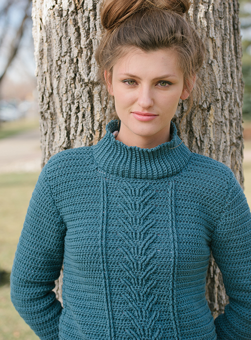 Front of Botany Pullover crochet sweater with cables