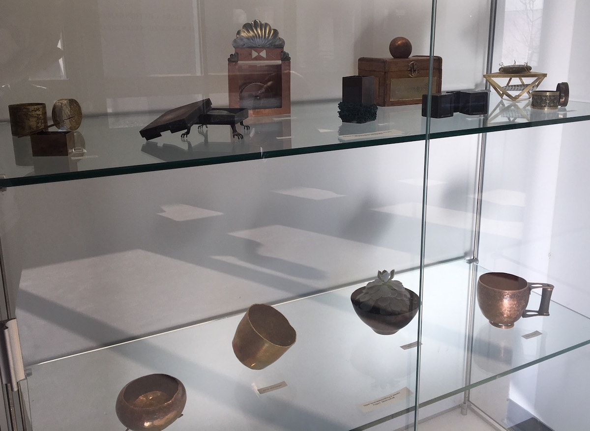 A display case showcasing work from student metalsmiths at CSU.