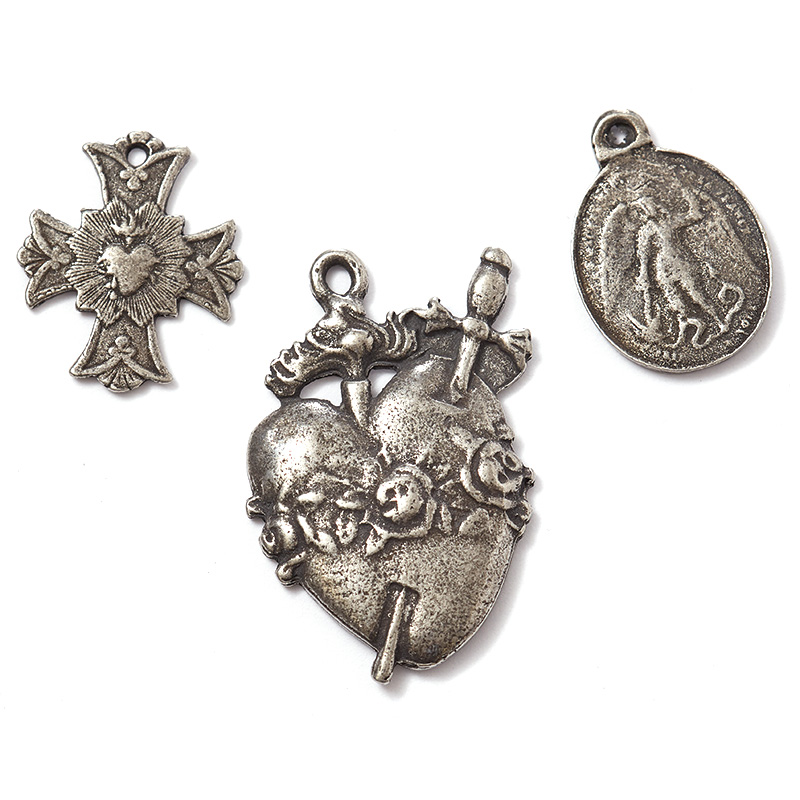 "The ""Saint"" line of pendants and charms includes reproductions of antique medallions."