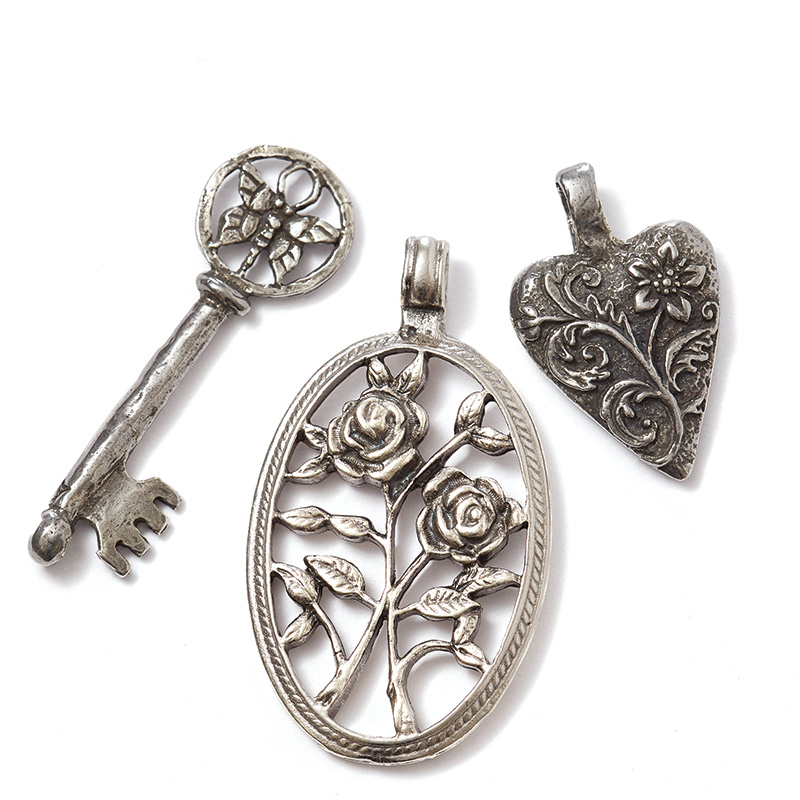 Cool stuff. Add a bit of whimsy and charm to your next design with new antiqued pewter beads, buttons, charms, and pendants from Tamara Scott Designs.