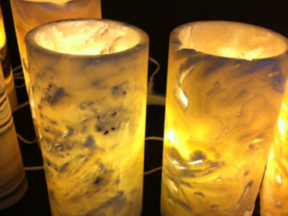 Calcite (onyx) lamps. Tucson Gem Show. February 2017. Photo by Merle White.