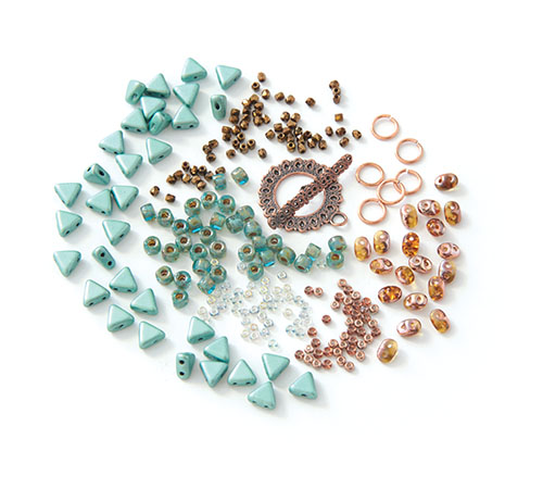 The BeadSmith bracelet challenge kit materials which include Khéops par Puca triangles, SuperDuos, True 2mm fire-polished rounds, size 6° seed beads, two colors of size 11° seed beads, and a copper-plated toggle clasp