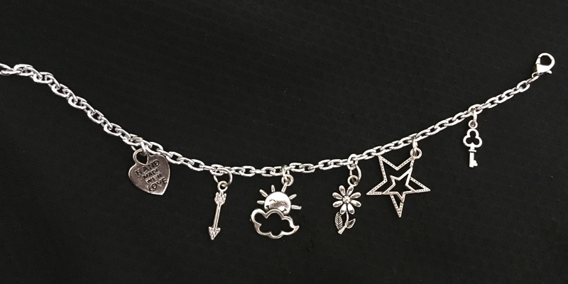 The charm bracelet being sold to raise money for cleft palate surgeries.