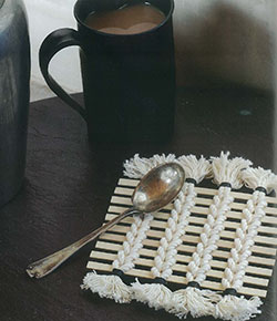 "Handwoven sticks and string coaster from ""Time to Weave"""