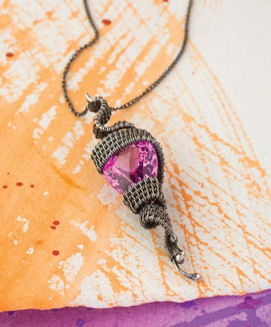 Coil the base on this wire weaving pendant by Sarah Thompson