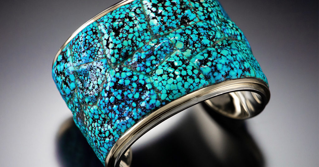 Bruce McKay, cuff bracelet, 2.8″ wide, 2″ tall, 2.4″ deep, 14K white gold, 18K yellow gold, natural Kingman spiderweb turquoise; photo: Dylan Brody