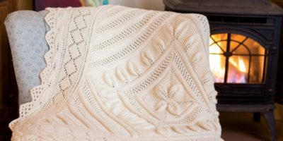 The Cottage Baby Blanket by Ava Coleman appears in Interweave Knits Summer 2015.