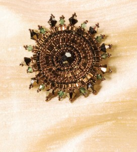 Learn how to make brooches with beads, such as this brooch called Crystal Radiance.