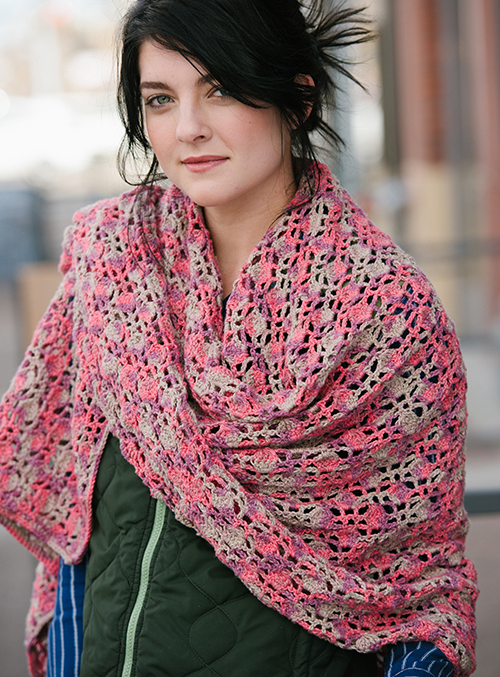 Dappled Crochet Shawl wrapped around shoulders