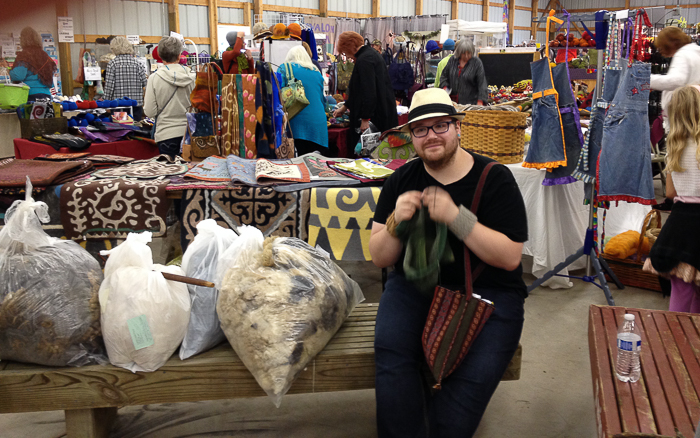Devin Helmen knitting his way through the Shepherd's Harvest festival. Devin is a gifted fiber artist from the Twin Cities. Learn more about his handspun, woven blanket project on his blog: A Few Green Figs. Photo courtesy of Devin Helmen.