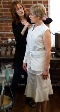 Susan Stowell fits Karen in the muslin for the Roman's Holiday suit. Photo by Bob Morris.