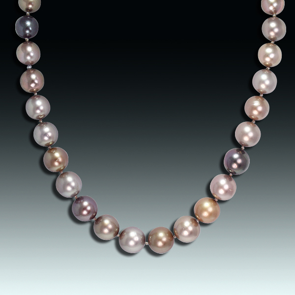 A strand of graduated, round cultured Tahitian chocolate pearls with 18 karat white gold, diamond-set clasp. Photo by Matthew Arden, courtesy Eve J. Alfillé Gallery & Studio, Evanston, Illinois.