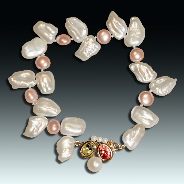 """This freshwater pearl bracelet, """"Nightlife II,"""" combining white and peach pearls of different shapes, shows just how varied pearls are. Accented with round white Akoya pearls, an oval peridot, an oval pink tourmaline, and a 14k yellow gold clasp. Photo by Matthew Arden, courtesy Eve J. Alfillé Gallery & Studio, Evanston, Illinois."""