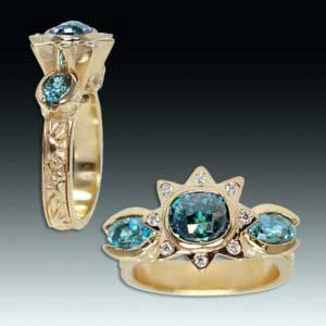 This beautiful 18k yellow gold ring is set with three blue zircons totaling 4.76 carats, and 12 diamonds with a total weight of .12 carats. Courtesy Eve Alfillé Gallery & Studio.