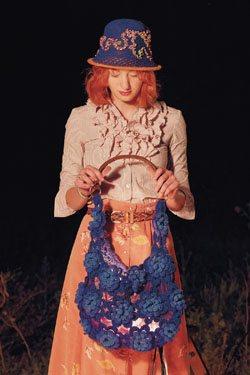 Crochet flower motifs make up this crochet purse.