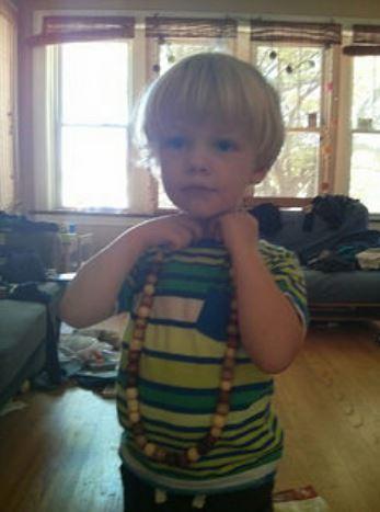 Ewan wearing beaded necklace
