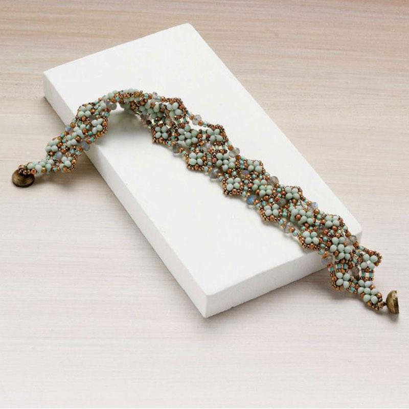 Vineyard Trellis bracelet by Pamela Lacasse using a combination of peanut, labradorite, and seed beads as seen in Favorite Bead Stitches 2017