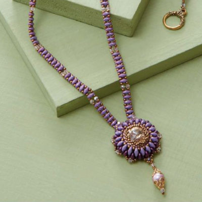 Try using SuperDuos to create the gorgeous bezeled rivoli in Maria Teresa Moran's Provence necklace