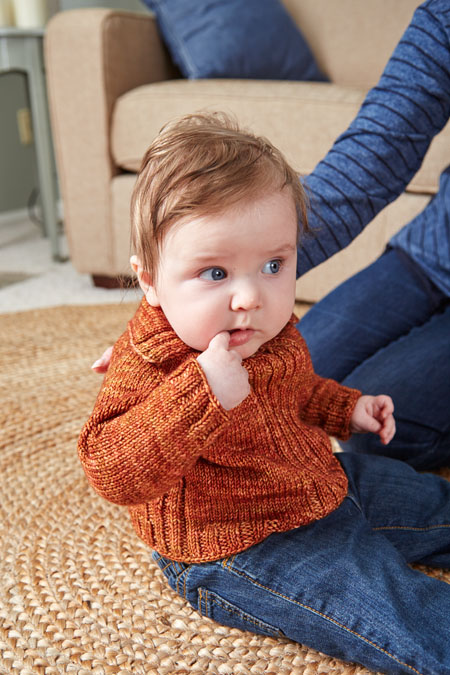 You'll love knitting this simple, top-down knitted pullover for baby that uses raglan shaping, and other techniques that will keep baby warm!