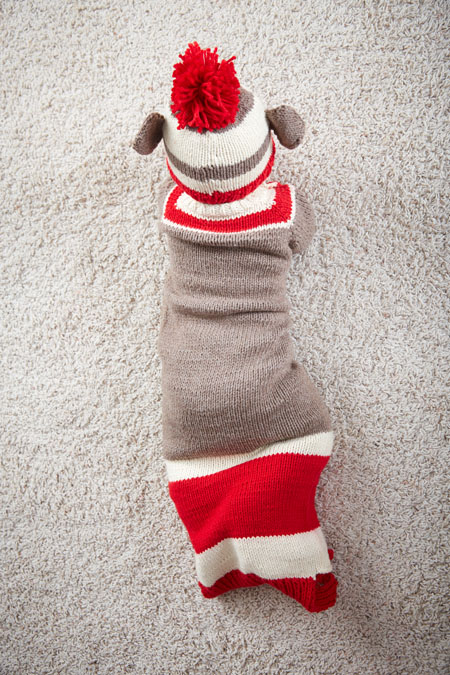 Keep baby warm during the cold winter nights with this adorable knitted onesie <a href=