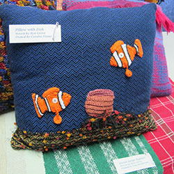 Handwoven pillow with surface embellishment