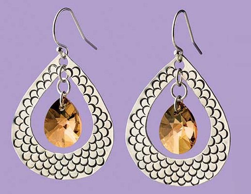 stamped metal jewelry: Aisha Formanski Tracks of My Tears Earrings Sterling silver, teardrop Swarovski crystal PHOTO: JIM LAWSON